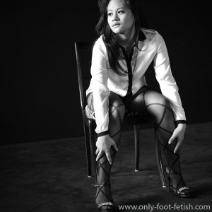 Julia B&W playing with a chair
