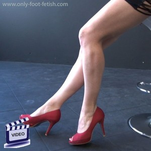 Athena in mini red heels on her feets
