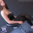 Mindy in black leggings black top and heels